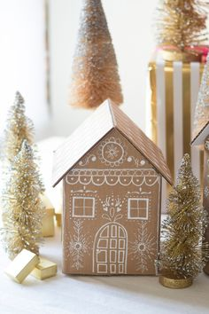 Upcycle unused cardboard boxes into festive and functional DIY gingerbread house gift boxes using hot glue and Painters paint markers. DIY Gingerbread house gift boxes created with cardboard and Painters makers. Christmas Projects, Holiday Crafts, Christmas Time, Gingerbread Christmas Decor, Christmas Decorations, Cardboard Gingerbread House, Gingerbread Houses, Ginger Bread House Diy, Natal Diy