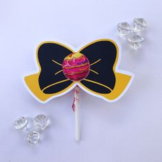 Yellow and black  bow lollipop holders by GlitterGlueDesigns on Etsy https://www.etsy.com/au/listing/512687672/yellow-and-black-bow-lollipop-holders