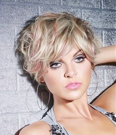A short blonde straight coloured choppy messy platinum hairstyle by L'anza