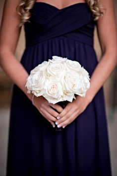 Simple and classic. Navy blue dress and white roses.