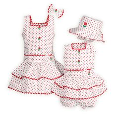 Bright and cheerful sister coordinates of cotton sheeting are sure to keep them comfortable on those hot summer days. Drop-waist dresses have cute tulip button front closures. Bow accent at waistlines. Knee lengths. Machine wash. USA made exclusively for us.