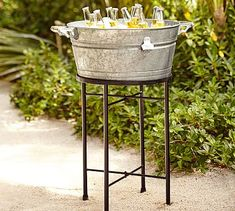 Keep your guests refreshed in farmhouse style. Our substantial party bucket is crafted from durable galvanized steel with solid wood handles and a bottle opener affixed to the side. Propped on our sturdy wrought-iron stand (sold separately), it en… Galvanized Buckets, Galvanized Metal, Tin Buckets, Outdoor Drinkware, Drink Bucket, Large Tv Stands, Tiered Stand, Bar Accessories, Free Interior Design