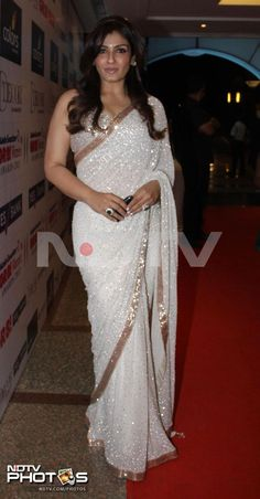 Actress Raveena Tandon looked stunning in a white sari at the 12th Gr8 Women Achievers Awards held in Mumbai.