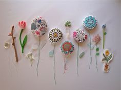 rocks/pebbles covered with vintage lace/crochet. wonderful way to re-cycle those torn or stained pieces.