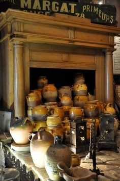 Old pottery in a fireplace, some have a large collection of terra cotta.