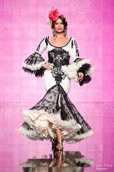 Alicia Cáceres, SIMOF 2014 black and white ruffle c bottom dress