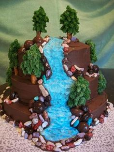 Waterfall cake:  This wilderness cake is a chocolate cake, chocolate frosting, chocolate candy rocks, chocolate covered raisins, chocolate bridge mix candy, pretzel rods