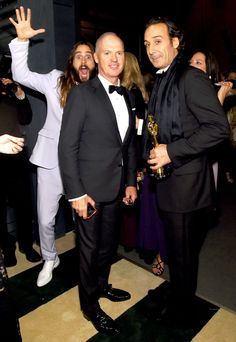 Behind you, Birdman! Oscar winner Jared Leto photobombed nominee Michael Keaton and winning composer Alexandre Desplat at the Vanity Fair Oscars bash on Feb. 22,2015