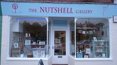 The sign goes up on the shop front - exciting!