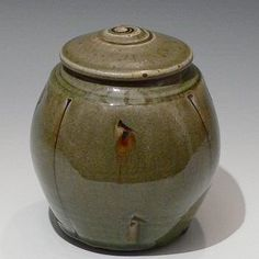 John Jelfs Squared stoneware caddy with incised decoration and celadon ash glaze.