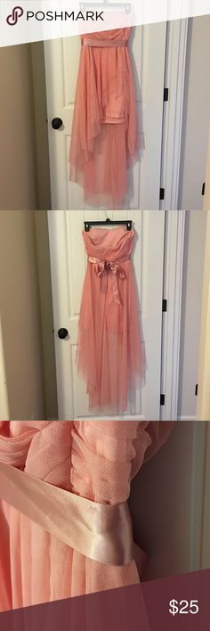 """Teeze Me formal dress This strapless salmon color dress would be great for any kind of occasion. Dance, wedding, etc. Only worn once, and still in great condition. The only """"problem"""" is there isn't a string on one side to hold the ribbon up, but the ribbon still stays up just fine without it. Super cute dress! Teeze Me Dresses Strapless"""