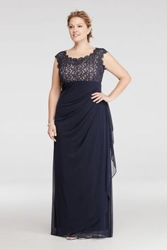 This dress is definitely a winner for any special event you are going to this season.  Dazzling cap sleeve glitter lace bodice has a scallop trim.  Long layered mesh skirt features ruching in front and back providing a cascading ruffle on side.  Designed by Xscape.  100% polyester lined. Center back zipper. Imported. Professional spot clean only. No direct heat or steam.  Also available in regular  To protect your dress, our Non Woven Garment Bag is a must have!