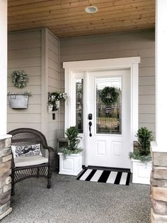 Home Remodel Floors A Bright and Crisp Cottage Front Porch Refresh with A Neutral Farmhouse Palette - Rain and Pine.Home Remodel Floors A Bright and Crisp Cottage Front Porch Refresh with A Neutral Farmhouse Palette - Rain and Pine Cottage Front Porches, Small Porches, Small Porch Decorating, Style Cottage, Cottage Style Front Doors, Veranda Design, Front Porch Design, Front Porch Planters, Building A Porch
