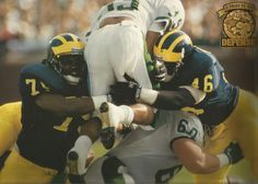 Tony Henderson and Marcus Walker.  Photo by Joe Arcure, from 1998 Michigan Wolverines Football Calendar, by The Victors Club
