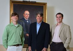 Philip Jackson, assistant professor of art, (photo far right) with students Thomas Grosskopf, B.F.A. (left) and Benny Melton, M.F.A. (middle) recently completed the restoration of the portrait of Alexander Lee Bondurant, professor of Latin, first dean of the graduate school, and founder of the UM football program. Over the years the circa 1900, oil on linen portrait of Professor Bondurant on display in Bondurant Hall had been defaced with pencils and markers. Photograph by Robert Jordan