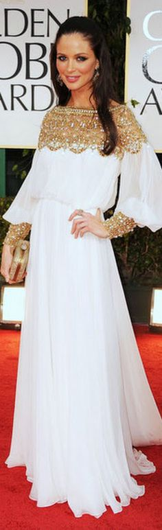 Georgina Chapman at Golden Globes in a white grecian Marchesa gown, with delicately embroidered gold neckline and cuffs.