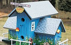 Check out this cheery birdhouse! Look. Even the bird house has bird houses.