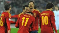 Spain's national football team players celebrate during the FIFA 2014 World Cup qualifying match