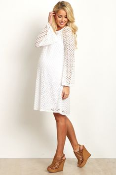 This pretty little number is the perfect versatile essential for any occasion. A gorgeous solid maternity dress with a lace overlay and bell sleeves that go beautifully with a pair of boots and a long necklace. Dress it up with a pair of heels and a statement accessory for a special event coming up.