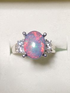 Amazing Australian Black Opal Ring with Genuine White Diamonds - Sterling Silver Genuine Opal Cocktail Ring - 14K Optional CUSTOM by OpalEmbers on Etsy https://www.etsy.com/listing/191905273/amazing-australian-black-opal-ring-with