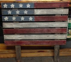 An American flag yard decoration made out of pallets