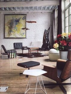 Eames + Barcelona Mies Lounge Chairs + gigantic frame map= vry nice
