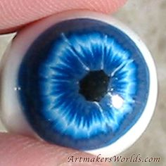 Make your own eyeballs with this..  Polymer clay eyeball cane.