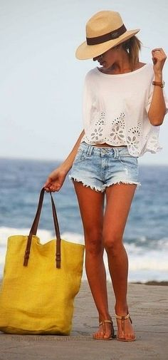Ripped denim shorts, white blouse with flower and cowboy hat | Women World Of Fashion