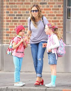 Mini fashionistas: The Sex and the City star teamed a grey sweatshirt with jeans rolled up at the hem, with her only pop of colour coming from her red strappy flats, but it was her girls who really stood out