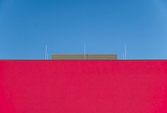 red, clear sky, copy space, architecture, exterior, blue, no people, outdoors, blue sky, place, day, sky