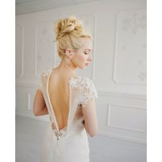 Featuring a delicately laced top with floral appliqué and a plunging neckline, this gorgeous dress also comes with a stunning illusion back with lace appliqué with a sweeping cathedral train, finishing the look for an elegant bride.