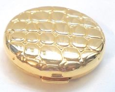 "ESTEE LAUDER ""GOLDEN ALLIGATOR"" pressed powder Collectible compact, Never used. Translucent 06. Wonderful condition. Measures 2 1/4 inches. No Box     Thank you for opening... #vtpassion #teamlove #vrev #bitzofglitz4u #vogueteam"