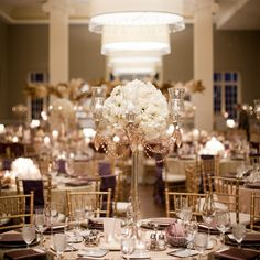 Gold Candelabra & Ivory Rose Centerpieces // photo: Olive Juice Studios // Centerpiece: Mimi Design // http://www.theknot.com/weddings/album/a-classic-elegant-wedding-in-minneapolis-mn-132793