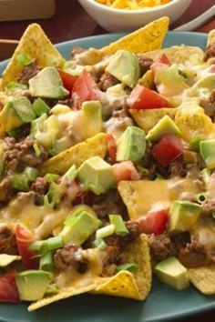 Add sour cream and diced avocados after removing nachos from oven.