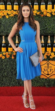 Nina Dobrev was the picture of perfection at the Veuve Clicquot Polo Classic in a marine blue pleated chiffon Badgley Mischka cocktail dress, complete with a gray oversize clutch and white strappy sandals.