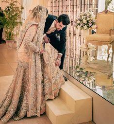 A real man always has his lady's back. Couple Wedding Dress, Pakistani Wedding Outfits, Disney Wedding Dresses, Pakistani Wedding Dresses, Wedding Hijab, Pakistani Bridal, Indian Bridal, Nikkah Dress, Bridal Lehenga
