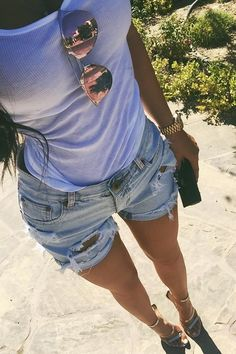 Kylie Jenner wearing Rolex Oyster Perpetual Day Date Gold-Diamond Watch, One Teaspoon Diamonde Chargers Shorts, Dior Cd Reflected Sunglasses and Tamara Mellon Frontline Metallic Nappa Sandals in Platino