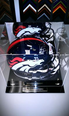 Just in time for the first pre-season game tonight! This is an Authentic Riddell Revolution (the model Manning uses) NFL Denver Broncos Helmet signed by our new quarterback, Peyton Manning! This would make a perfect birthday or early Christmas gift for that die hard Broncos fan in your life! Manning memorabilia is limited, so jump on this while you can! Only available at FastFrame of LoDo!