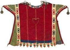 """Probably Yomut Turkmen, 2nd quarter 20th c., kurte (child's poncho-like garment), handwoven and machine-made cotton and silk: imported wool-broadcloth triangles; cloth amulet (doga); black/white """"snakes"""" trim; ladder and running stitches; printed-cotton lining; two Russian 10-kopek coins dated 1925. The kurte is imbued with protective power – the """"snake"""" trim, dangling coins, and triangles all serve as talismans."""
