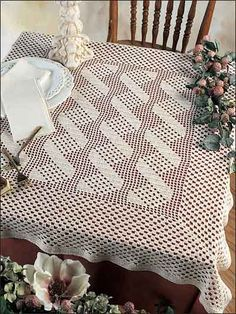 "Crochet this easy tablecloth for a nice table setting.    Finished size: 35"" x 37"". Made with crochet cotton thread size 10 and size 7 steel crochet hook. Free Crochet Pattern"