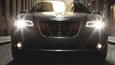 The 2014 Chrysler 300S shown with a black chrome grille and front fascia accents.