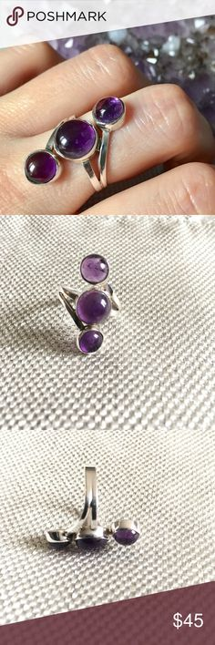 Amethyst Sterling Silver Ring Size 7 Cluster of three amethyst stones set in an authentic .925 stamped sterling silver ring. Size 7. Made in Los Angeles. Jewelry Rings