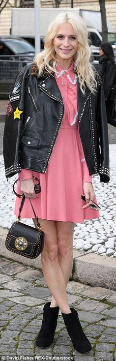Striking: Poppy Delevingne was also dressed to impress in a ladylike pink dress...