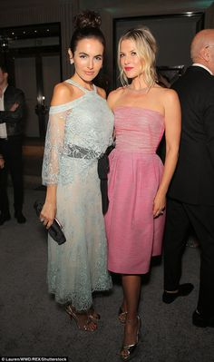 Feminine frocks: Camilla wore a delicate light blue lace dress, while Ali opted for a pretty pink strapless look