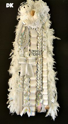 Triple Homecoming Mum by DK Florals now serving the Denton county area to include Frisco, Mckinney, Plano, and Little Elm. Call us 682-235-MUMS. We ship nationwide.