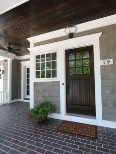 dark wood front door gray house white trim