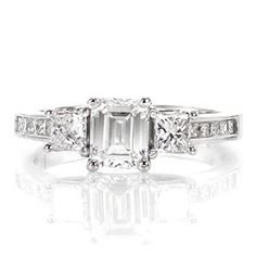 This contemporary design uses the contrast of straight lines and vibrantly faceted princess cut diamonds to create a striking statement. The cascading step-cut facets of the 0.75 carat emerald cut center diamond stand out from the side stones and the channel set diamonds on the band.  #engagement #wedding #ring www.knoxjewelers.biz
