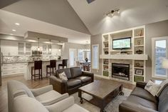 Family Room Design Ideas, Pictures, Remodel, and Decor - page 252--love the bookcase, tv, fireplace!