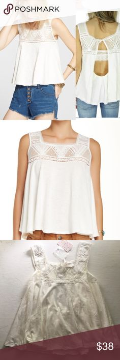 Free People Costa Mesa Tank NWT New with tags- features beautiful sheer paneling and embroidery with draped open back- cleaning of closet- open to offers!- no trades- closet closes August 10th Free People Tops