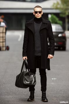Shop this look on Lookastic: http://lookastic.com/men/looks/sunglasses-boots-holdall-jeans-overcoat-crew-neck-sweater-turtleneck/6879 — Black Sunglasses — Black Leather Boots — Black Leather Holdall — Black Jeans — Black Overcoat — Charcoal Crew-neck Sweater — Black Turtleneck
